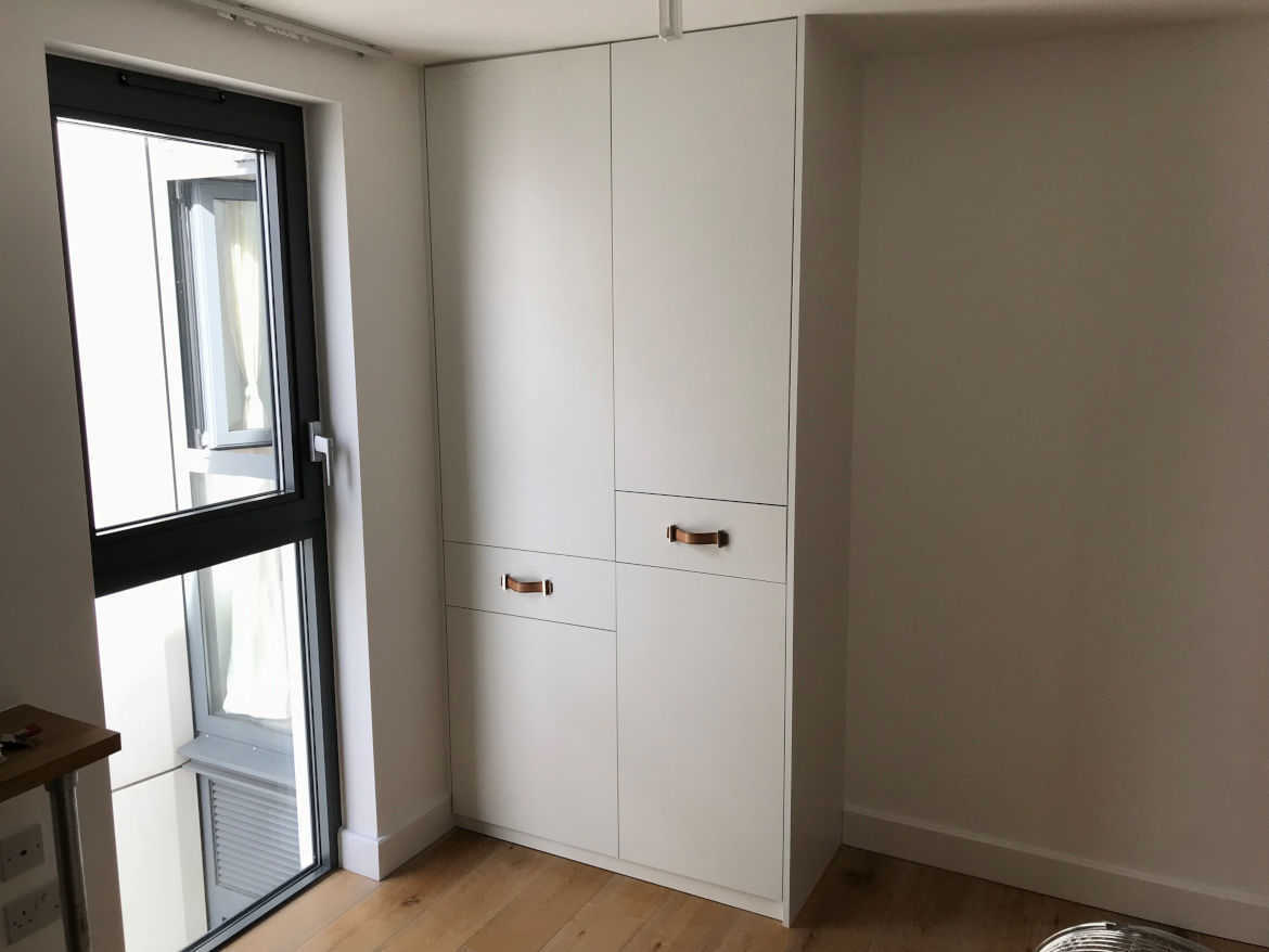 plain white bespoke cupboard