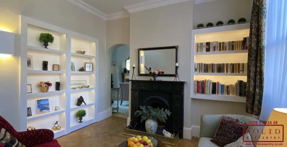 alcove bookcase with lights