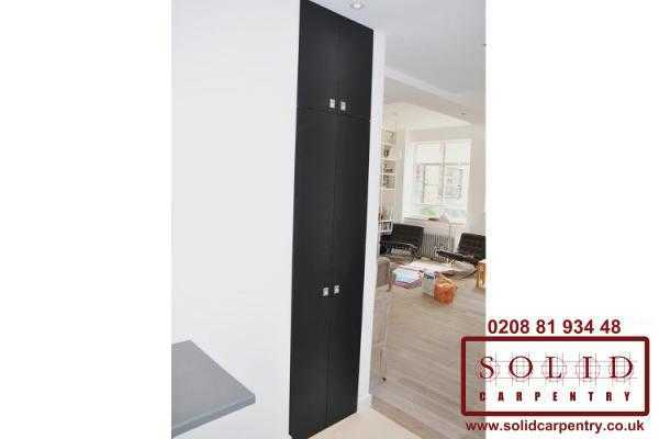 Black doors built in cupboard