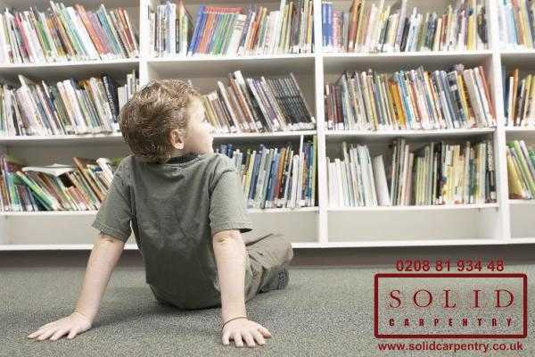 Child and bookcase