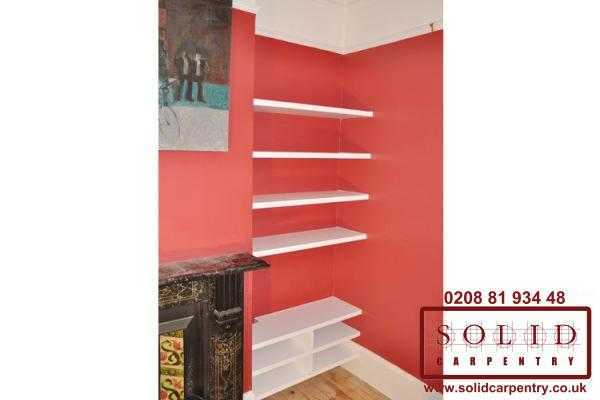 floating shelves on red walls