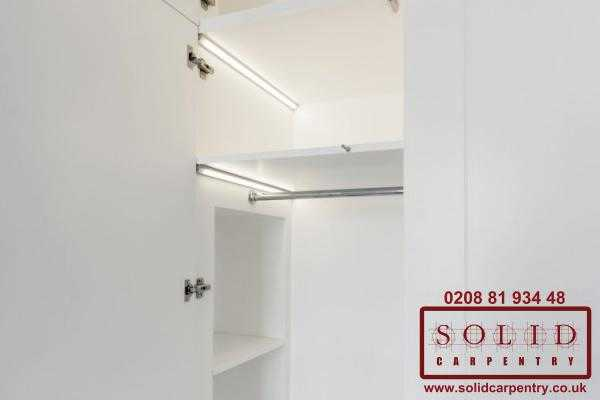 Push to open white wardrobe