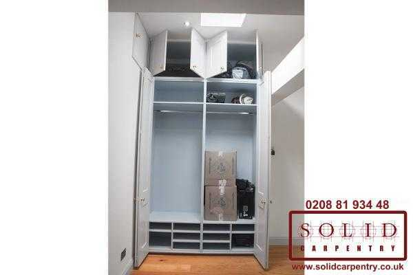 Wardrobe with folding doors
