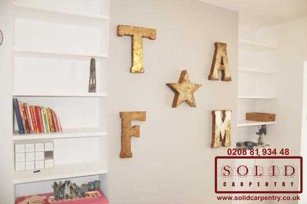 floating shelves and letters on the wall
