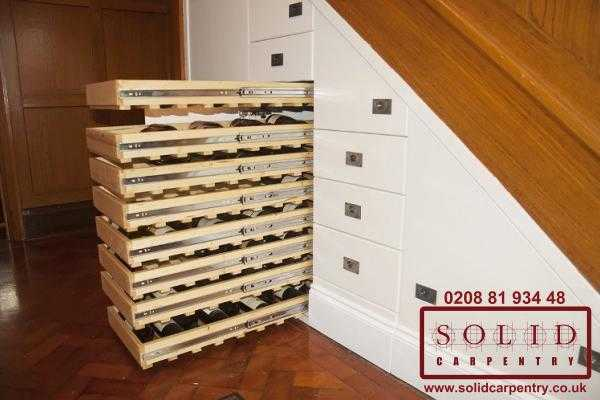 Massive wine storage under the stairs