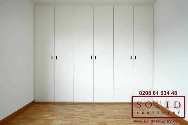 Wall to wall wardrobe with open doors