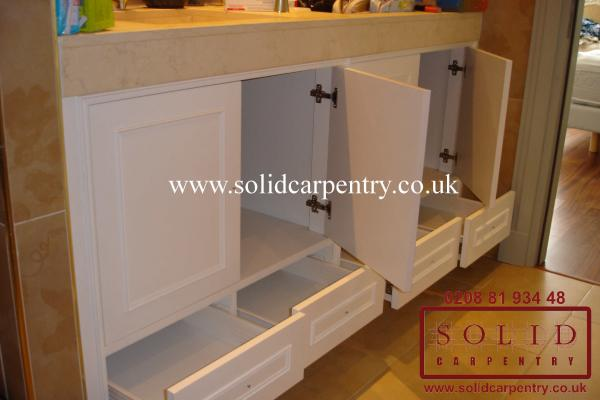 A view of the doors, drawers and shelving  for  the third vanity unit